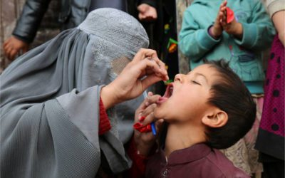 A child is vaccinated in Kandahar Afghanistan